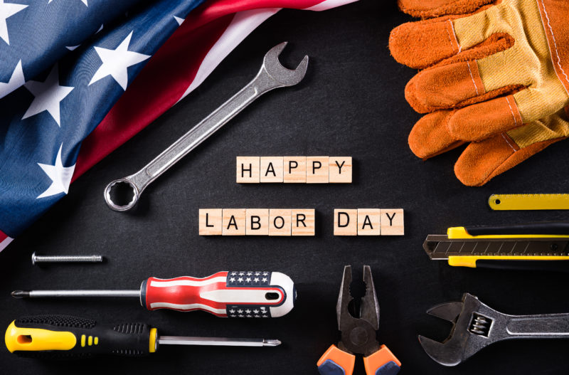 Happy Labor day concept. American flag with different constructi